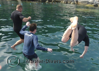 Harry, Mark and Sigbourne jump into the water to do their swim test.