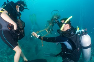 Divers on one of our 'Dive against Debris' days, removing trash from the coral reef.